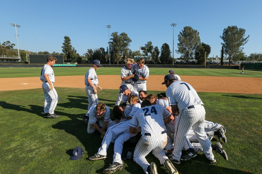 The Granite Hills Eagles celebrate after a walk-off base hit wins the CIF Division I title Saturday at Poway High.