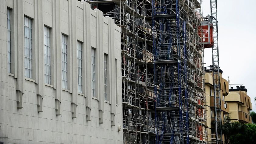 New residential construction rises next to the iconic Wilshire Tower on the Miracle Mile.