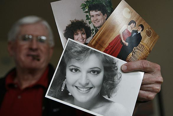 Jim Palin, father-in-law of Alaska Gov. Sarah Palin, shows family photos of the newly selected GOP running mate: the former Sarah Heath as beauty contestant; Sarah with her high school prom date, Todd; and Sarah and Todd again in 1991, after their marriage.