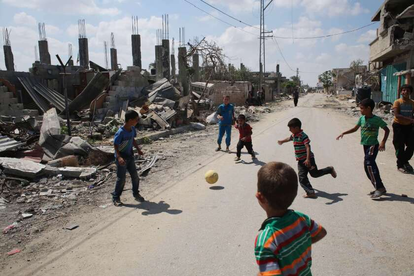 Palestinian children play near a destroyed house in Khan Yunis in the southern Gaza Strip on Sept. 11.