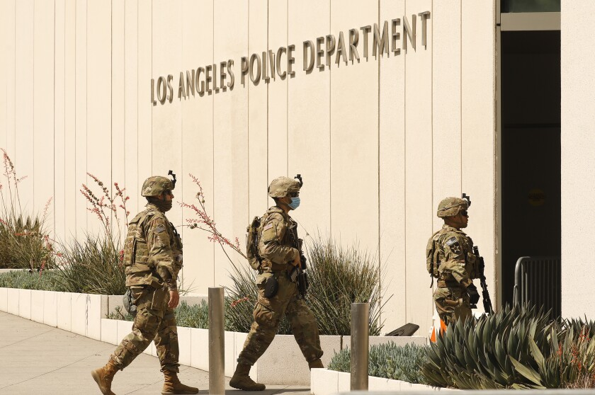 National Guardsmen patrol outside the Los Angeles Police Department headquarters in downtown L.A.