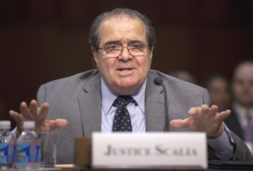 """Supreme Court Justice Antonin Scalia testifies on Capitol Hill in Washington, Wednesday, Oct. 5, 2011, before the Senate Judiciary Committee hearing; """"Considering the Role of Judges Under the Constitution of the United States."""" (AP Photo/Evan Vucci"""