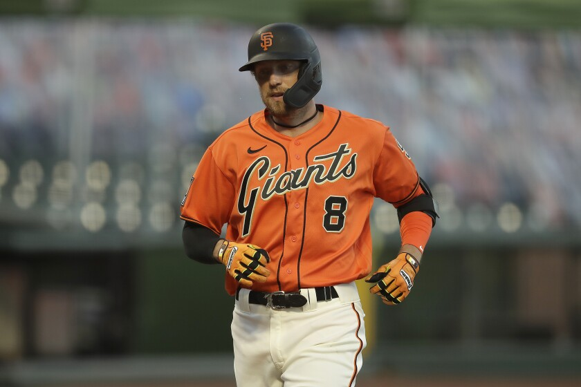 The Giants' Hunter Pence rounds the bases after homering against the Athletics on Aug. 14, 2020.