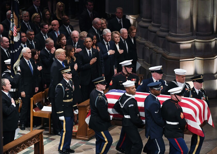 Former President George W. Bush, President Trump and former Presidents Obama, Clinton and Carter and others look on during a funeral service for former President George H.W. Bush at Washington National Cathedral on Wednesday.