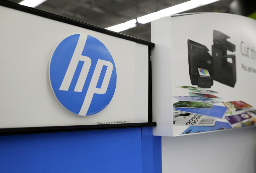 """FILE - In this May 24, 2016, file photo, Hewlett-Packard products are on display at a store in North Andover, Mass. Computer and printer maker HP Inc. said Wednesday, Nov. 6, 2019, that it has received a """"proposal"""" from copier maker Xerox and has had conversations """"from time to time"""" with the company about a potential business combination. (AP Photo/Elise Amendola, File)"""