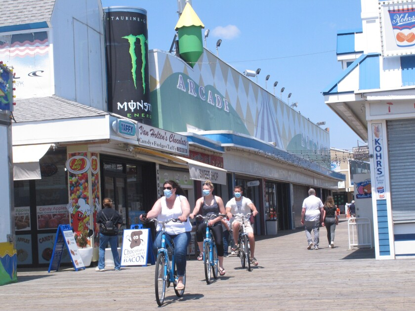 Bicyclists ride on the boardwalk in Seaside Heights, N.J., on May 15.
