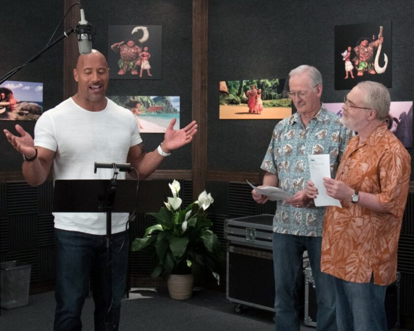 """Dwayne """"The Rock"""" Johnson with """"Moana"""" directors John Musker, left, and Ron Clements."""