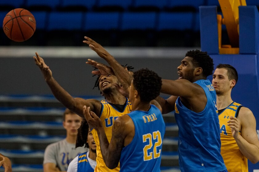 Members of the Gold and Blue teams scramble to grab a loose ball as the UCLA Bruins hold a preseason showcase at Pauley Pavilion on Wednesday in Westwood.