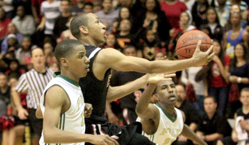 Etiwanda's Jordan McLaughlin, center, ranked the sixth-best prospective point guard in the country by several publications, is among the highlights of USC Coach Andy Enfield's first recruiting class.