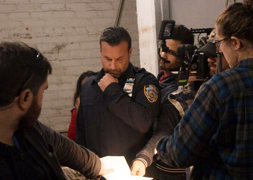 """Former NYPD officer Steve Stanulis (center), while wearing a police uniform on the set of """"The Fifth Boro,"""" was called into action by a Brooklyn woman who thought he was actually a cop."""