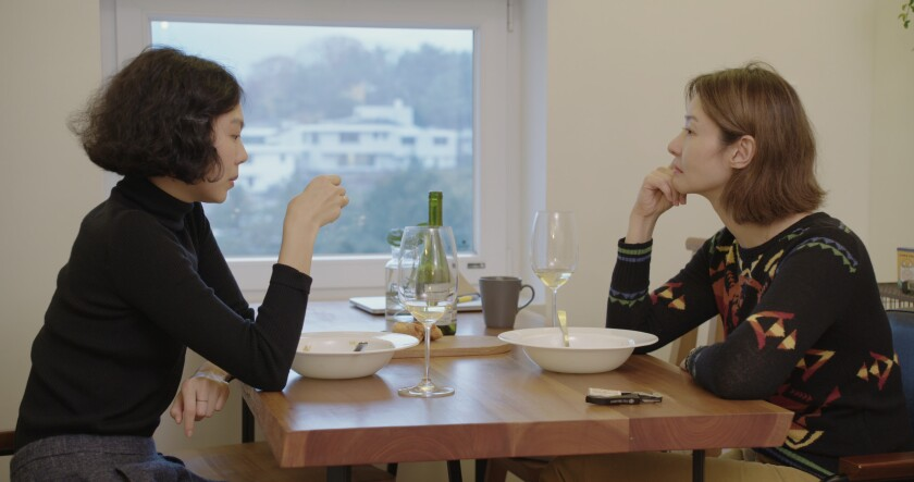 "Kim Min-hee and Song Seon-mi in Hong Sang-soo's movie ""The Woman Who Ran."""