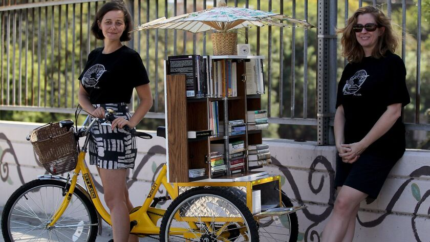 LOS ANGELES, CALIF. - SEP. 21, 2014. The Feminist Library on Wheels is a project of Jenn Witte, lef