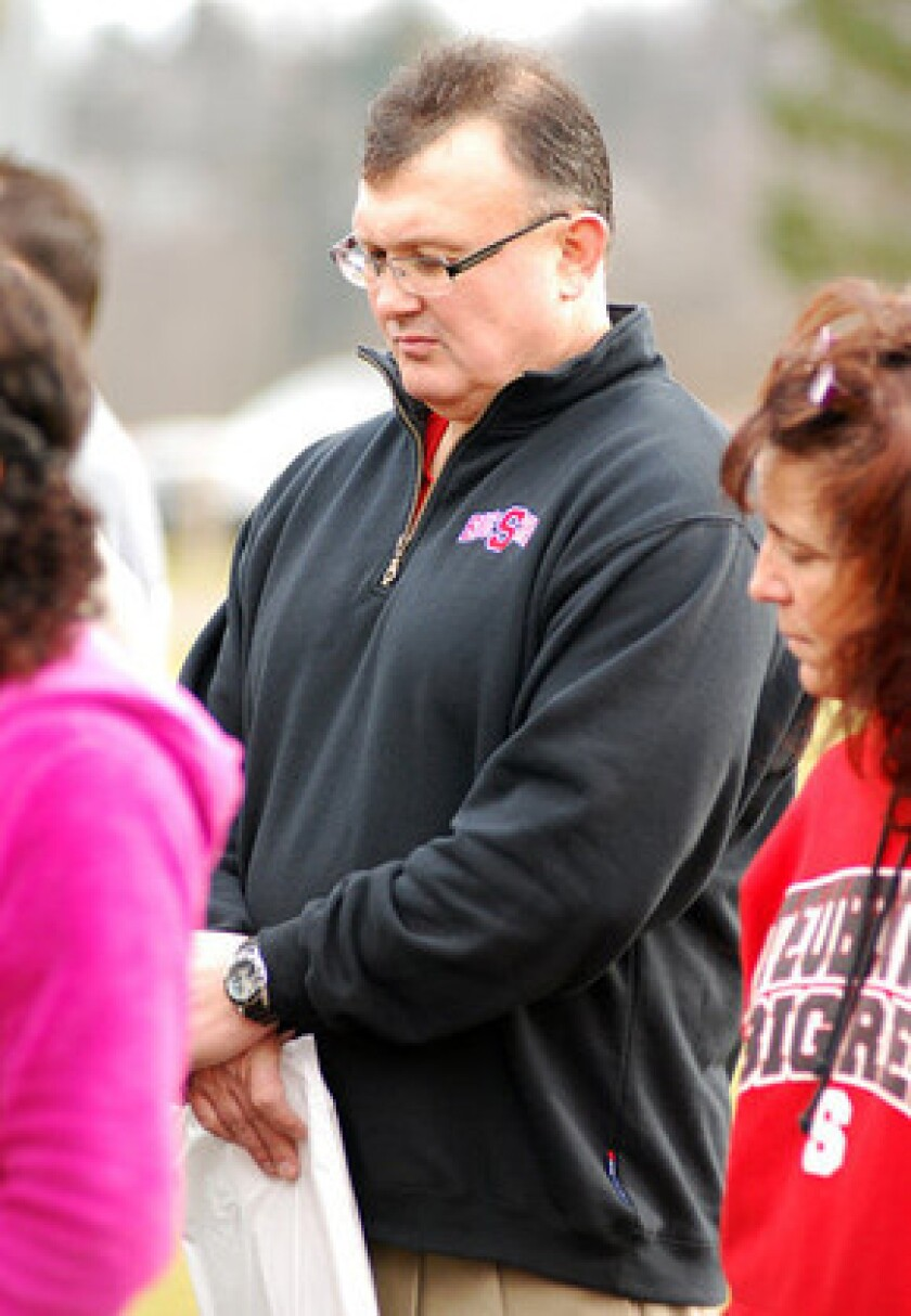 Steubenville City Schools Supt. Michael McVey prays during a Stand Up For Steubenville rally at Jim Wood Park in Steubenville, Ohio. McVey was indicted by a special grand jury and charged with two counts of obstructing justice, and single counts of falsification and tampering with evidence in the conviction of two Steubenville high school football players of raping a West Virginia girl after an alcohol-fueled party in August 2012.