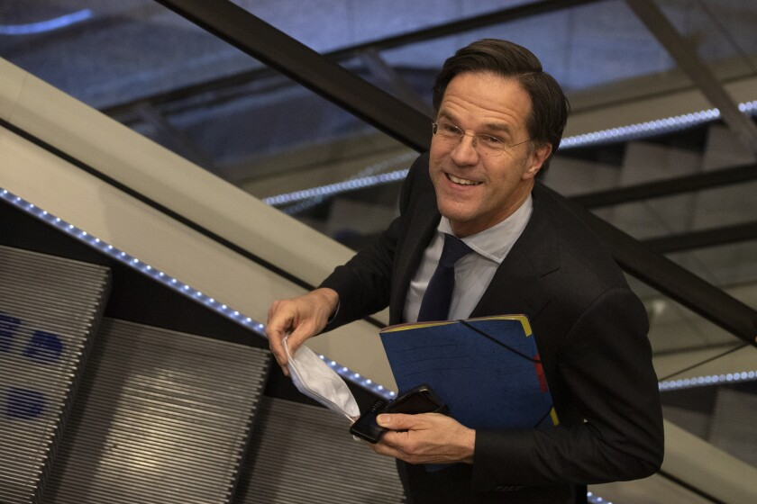 FILE - In this file photo dated Friday, April 2, 2021, caretaker Dutch Prime Minister Mark Rutte leaves after surviving a no-confidence motion in parliament in The Hague, Netherlands. The Dutch government on Tuesday April 13, 2021, presented a roadmap for relaxing coronavirus lockdown measures, but caretaker Prime Minister Mark Rutte said it is still too early to relax the country's months-long lockdown. (AP Photo/Peter Dejong, FILE)