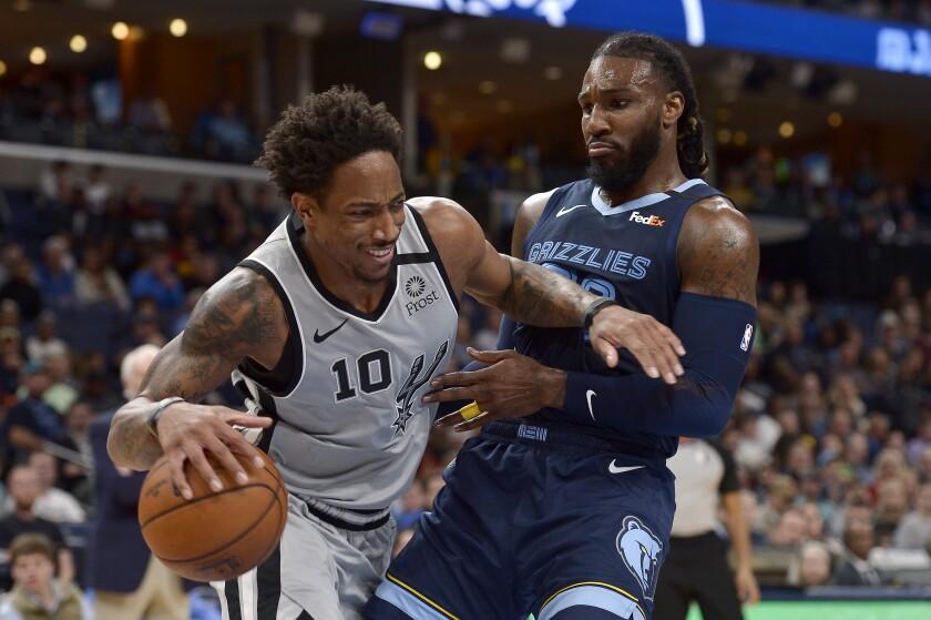 San Antonio Spurs guard DeMar DeRozan (10) handles the ball against Memphis Grizzlies forward Jae Crowder in the second half of an NBA basketball game Friday, Jan. 10, 2020, in Memphis, Tenn. (AP Photo/Brandon Dill)