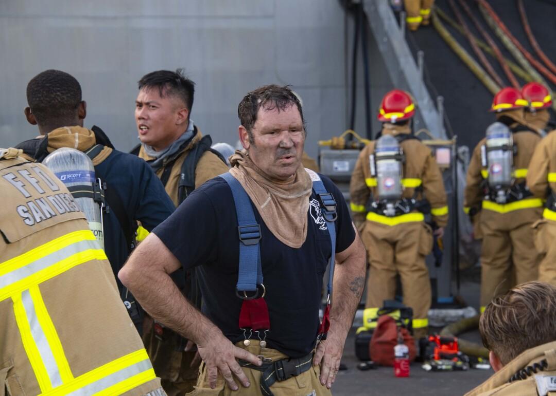 Firefighter John Farrell emerges from USS Bonhomme Richard on July 13.