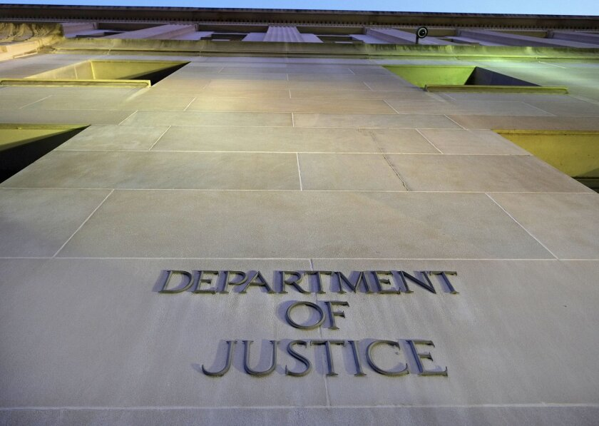 FILE - In this May 14, 2013, file photo, the Department of Justice headquarters building in Washington is photographed early in the morning. The Justice Department has signaled that it won't try to block a lawsuit arising from the CIA's harsh interrogation techniques, leaving the door open for a court challenge over tactics that have since been discontinued and widely discredited. (AP Photo/J. David Ake, File)