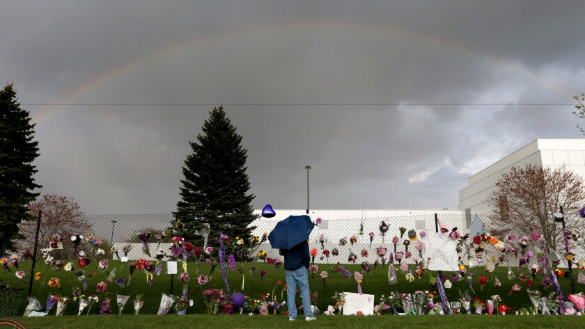 A rainbow appears over Paisley Park near a memorial for Prince, in Chanhassen, Minn., in April 2016.