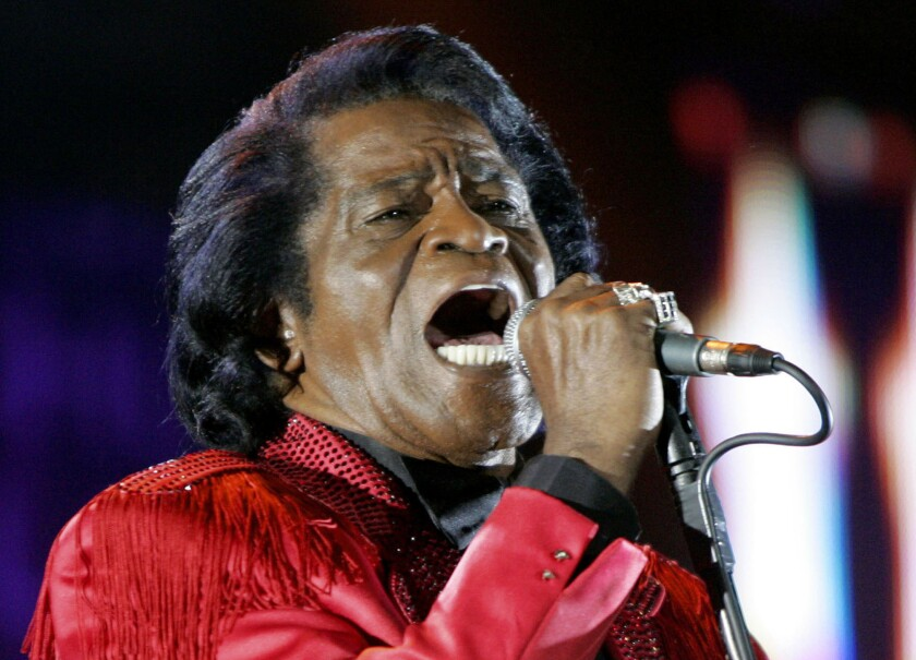 FILE - In this July 6, 2005 file photo, James Brown performs on stage during the Live 8 concert at Murrayfield Stadium in Edinburgh, Scotland. The family of entertainer James Brown has reached a settlement ending a 15-year battle over late singer's estate. David Black, an attorney representing Brown's estate, confirmed to The Associated Press on Friday, July 23, 2021 that the agreement was reached July 9. (AP Photo/Matt Dunham, File)