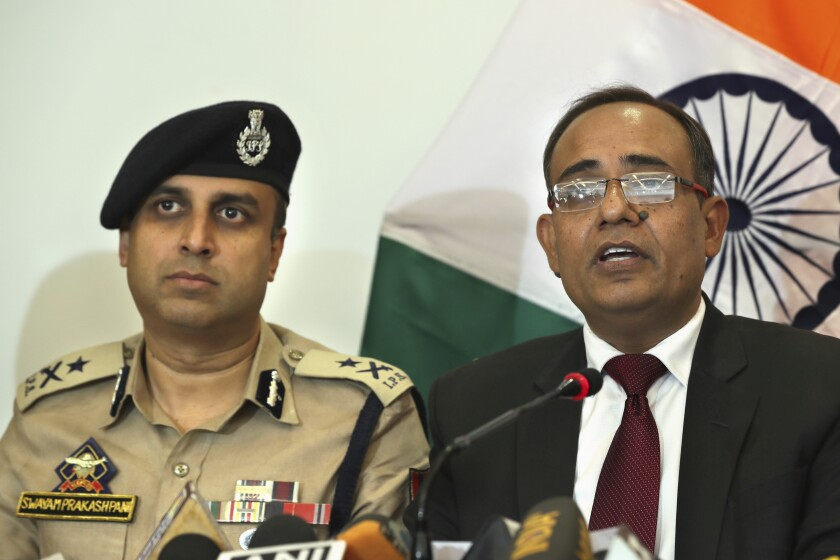 Government spokesperson Rohit Kansal, right, speaks as Swayam Prakash Pani, left, Inspector General of Police of Kashmir Range during a press conference, sits beside him in Srinagar, Indian controlled Kashmir, Saturday, Oct. 12 2019. The Indian government on Saturday announced that all post paid mobile phone will be restored on Oct. 14, 70 days after a communication blockade was put in place in disputed Kashmir. (AP Photo/Dar Yasin)