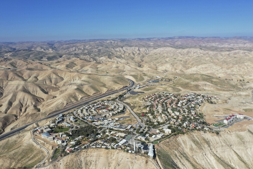 """FILE - This Jan. 26, 2020, file photo, shows a view of the West Bank Jewish settlement of Mitzpe Yeriho. The United Nations Human Rights Council released a list of more than 100 companies it says are operating in Israel's West Bank settlements. In a report Wednesday, Feb. 12, 2020, the council said the companies' activities """"""""raised particular human rights concerns."""" The list is dominated by Israeli companies, but it also lists a number of international firms. (AP Photo/Oded Balilty, File)"""