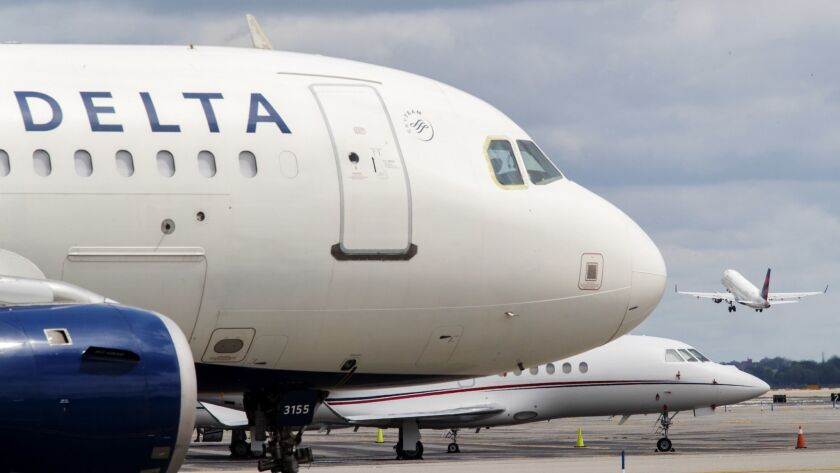 In a file photo, a Delta Air Lines jet waits on the tarmac at LaGuardia Airport in New York.
