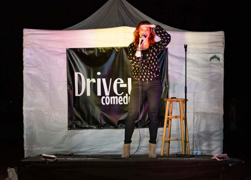 Comedian Jodi Miller performing at Drive-Up Comedy, held in Kit Carson Park in Escondido.