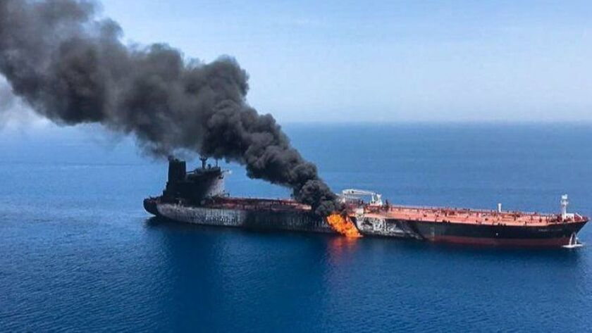 Smoke billows from the Norwegian-owned Front Altair tanker said to have been attacked in the waters of the Gulf of Oman.