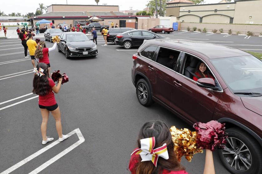Estancia High varsity athletes pull forward at a spring sports drive-through banquet at Newport Rib Company  on Tuesday.