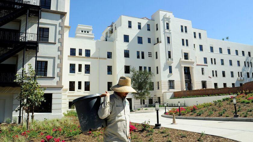 LOS ANGELES-CA-SEPTEMBER 18, 2015: A gardener works in the yard at the former Linda Vista Hospital t