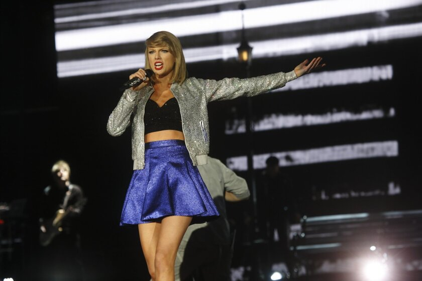 FILE - In this May 15, 2015 file photo, Taylor Swift performs at Rock in Rio USA at the MGM Resorts Festival Grounds in Las Vegas.  Apple's abrupt about-face on paying royalties for songs during a three-month free-trial period for its new music service was a symbolic victory for superstar Swift and