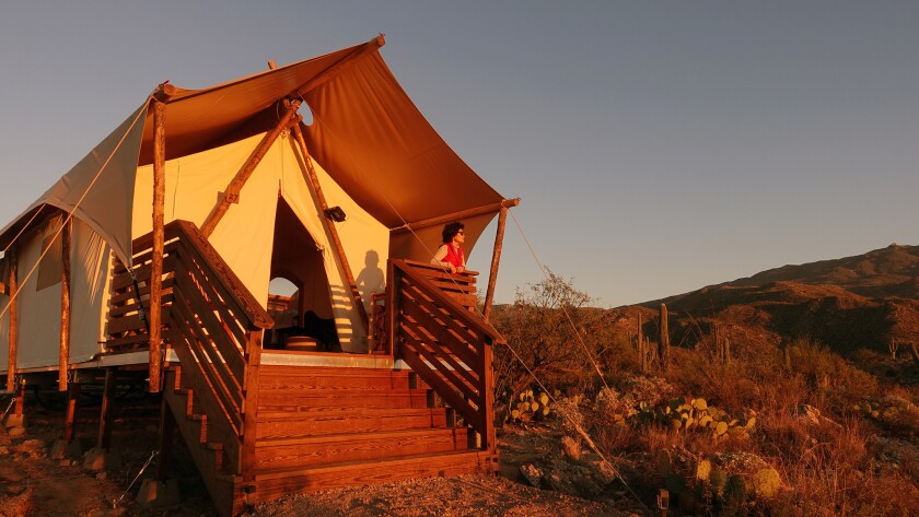 Tucson, AZ – December 19, 2018: Under Canvas Tucson glamping tents are set up on a desert hillside a