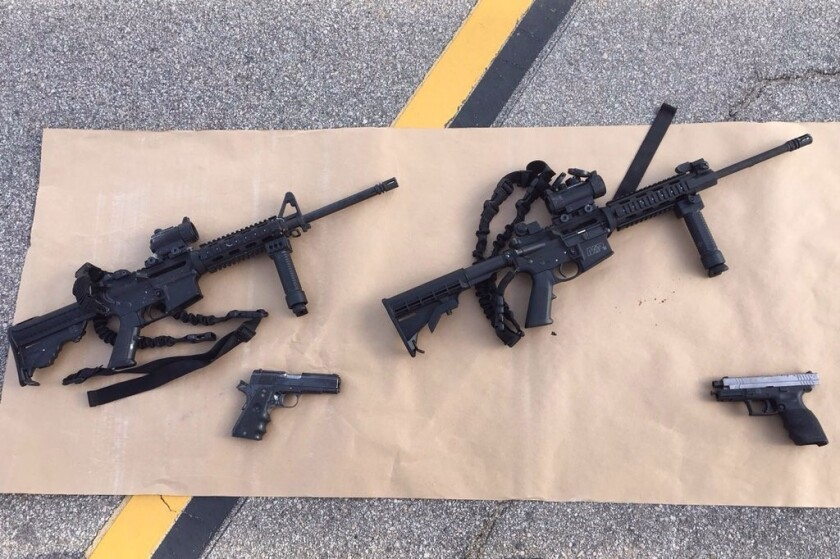In this handout photo provided by the San Bernardino County Sherrif's Department, four guns are seen near the site of a Dec. 4 shootout between police and suspects in San Bernardino.