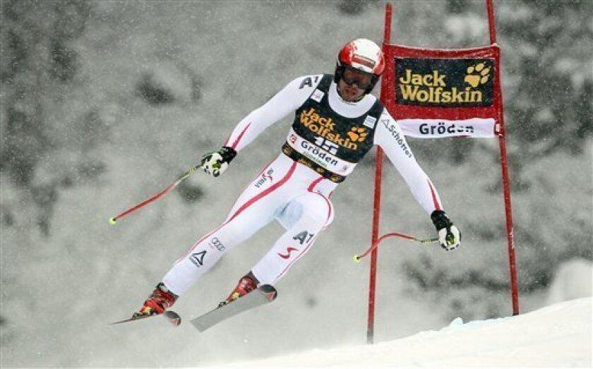 Austria's Joachim Puchner competes during an alpine ski, men's World Cup downhill, in Val Gardena, Italy, Saturday, Dec. 15, 2012. (AP Photo/Alessandro Trovati)