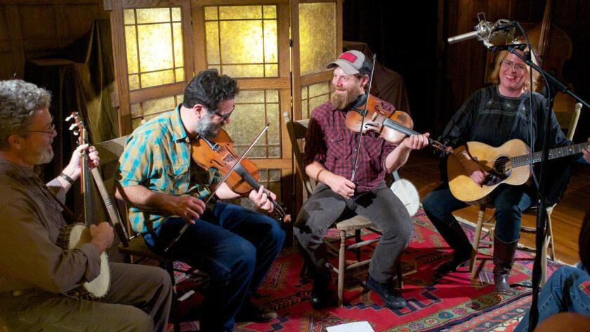 Fiddler and banjo player Ben Townsend, second from right, performs with Joe Wack, Ben Guzman and Kelly Martin as part of the Deep End Sessions old-time music series in Santa Paula in 2014.