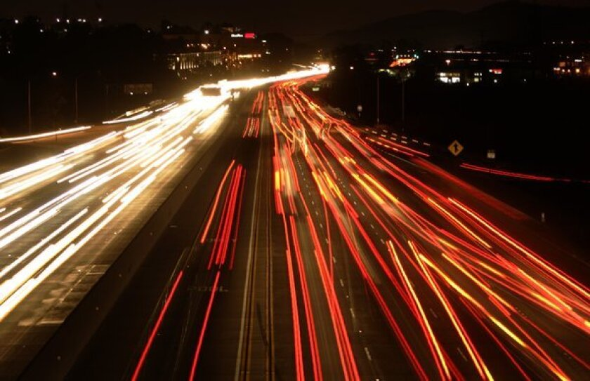 Traffic on the 5 Freeway at night looking south from Oso Parkway moves at a crawl.