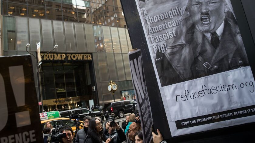 A small group of Donald Trump critics rallies across the street from Trump Tower.