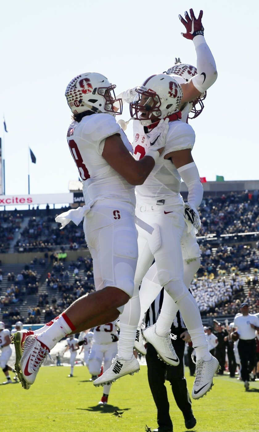 Stanford wide receiver Michael Rector, center, celebrates his touchdown catch with tight end Austin Hooper, left, and wide receiver Treyvion Foster during the first half of an NCAA football game against Colorado, Saturday, Nov. 7, 2015, in Boulder, Colo. (AP Photo/David Zalubowski)