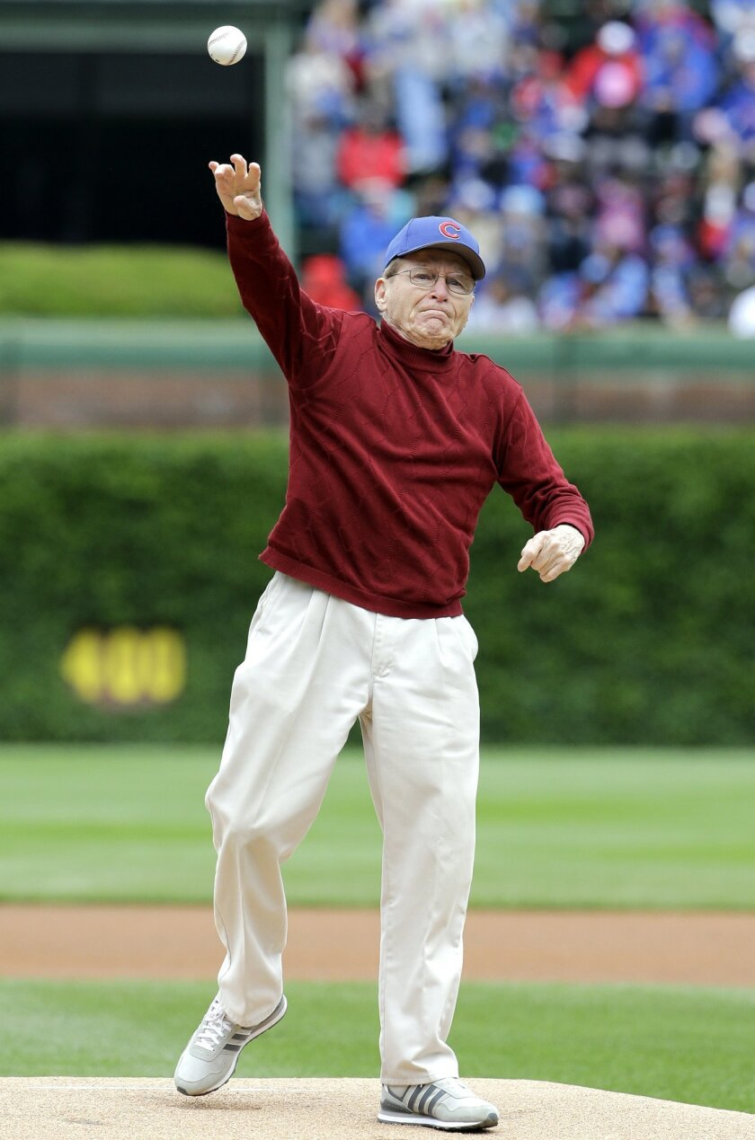 Tony Gianunzio throws out a ceremonial first pitch before an interleague baseball game between the Kansas City Royals and the Chicago Cubs Sunday, May 31, 2015, in Chicago. More than 70 years after he hoped to make his major league debut, World War II veteran Gianunzio fulfilled his goal of pitching at Wrigley Field. (AP Photo/Nam Y. Huh)