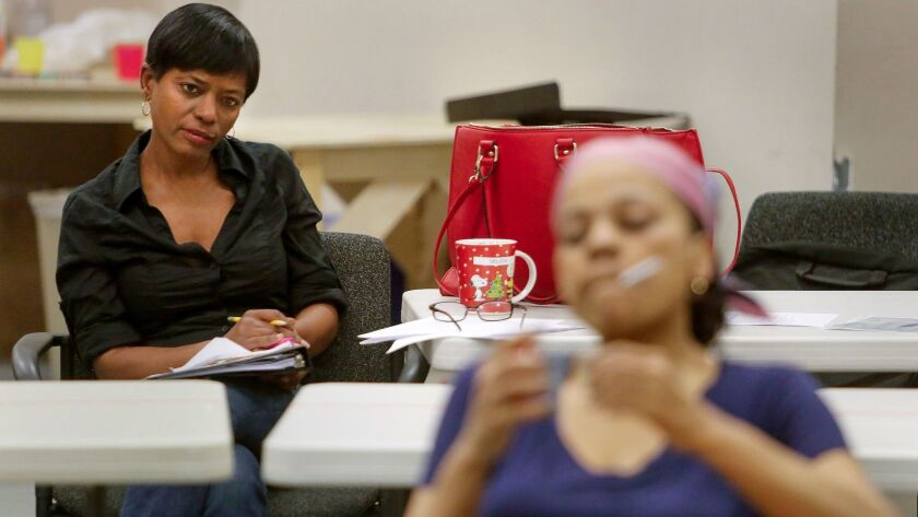 Director Delicia Turner Sonnenberg (left) looks on as Tonye Patano rehearses a scene from the Old Gl