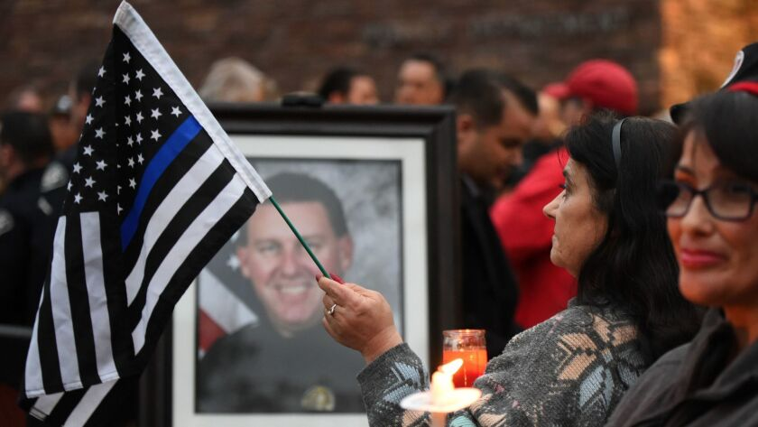 Slain officer Keith Boyer is remembered during a vigil at the Whittier police station on Feb. 20.