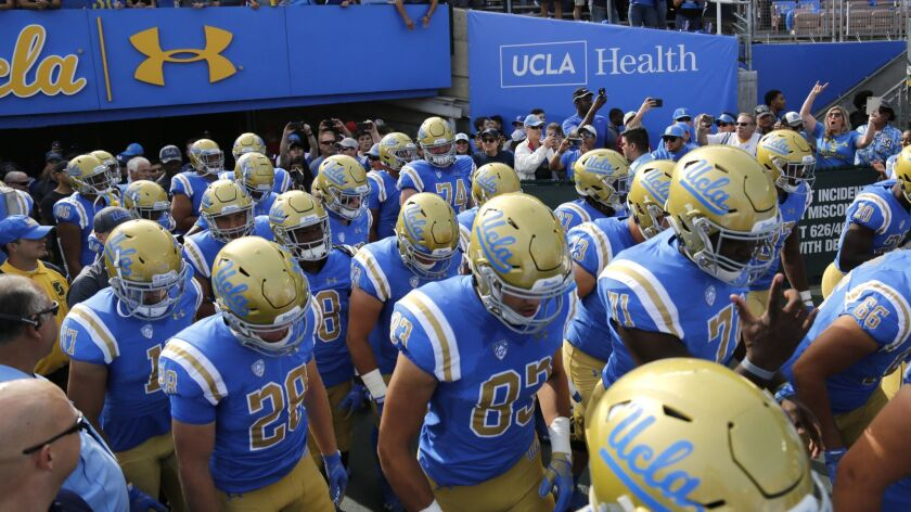 The UCLA Bruins take the field for their game against USC at the Rose Bowl on Nov. 17.