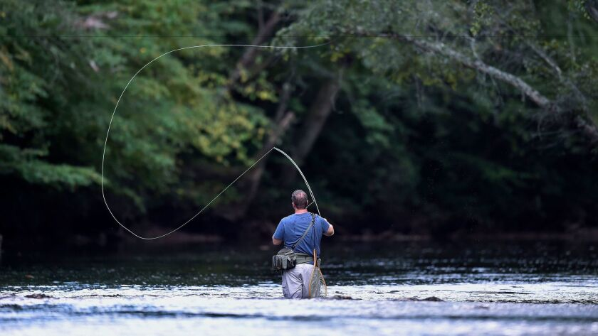 Kevin Mangum, lead pastor of the River Point Community Church in Cornelia, fly fishes on the Chattah