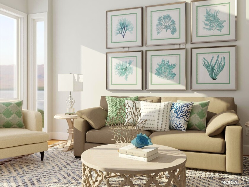 """This undated photo rendering provided by Modsy shows a room decorated like an island getaway. Alessandra Wood, founder of online interior design platform Modsy, says you can invoke the vibe of your favorite island getaway through some well-chosen prints and materials. """"Look for pieces that have a subtle tropical vibe via foliage, like palms, as well as natural raw wood or rattan textures, and fun global prints."""" To achieve a coastal getaway look, Wood suggests opting for layers of serene blues and seafoam greens paired with neutral hues. """"This will evoke the sea and the sand and create a calming backdrop. To really feel like you're on a beach getaway incorporate sea themed items such as prints, sculptures, and objects that depict shells and sea life."""" (Modsy via AP)"""