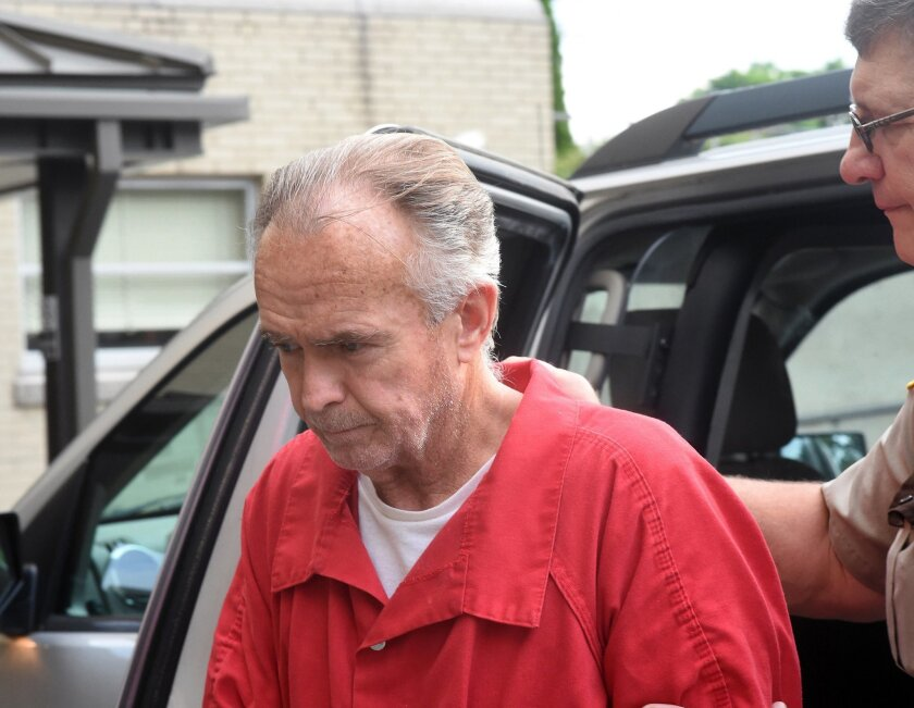 FILE - In this June 30, 2014, file photo, Arthur Schirmer is led into the Lebanon Municipal Building in Lebanon, Pa. The former Pennsylvania pastor already serving life without parole for bludgeoning his second wife to death in 2008 is scheduled to be sentenced Wednesday, Sept. 10, 2014, in the 1999 death of his first wife. (AP Photo/Lebanon Daily News, Earl Brightbill, File) THE PATRIOT-NEWS OUT