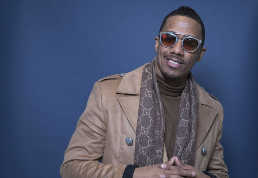 """FILE - In this Dec. 10, 2018, file photo Nick Cannon poses for a portrait in New York. Cannon's """"hateful speech"""" and anti-Semitic conspiracy theories led ViacomCBS to cut ties with the performer, the media giant said. """"ViacomCBS condemns bigotry of any kind and we categorically denounce all forms of anti-Semitism,"""" the company said in a statement Tuesday, July 14, 2020. It is terminating its relationship with Cannon, ViacomCBS said. (Photo by Amy Sussman/Invision/AP, File)"""