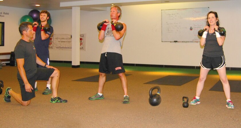 Revolution Fitness in La Jolla uses simple exercise equipment, like kettlebells, to build strength.