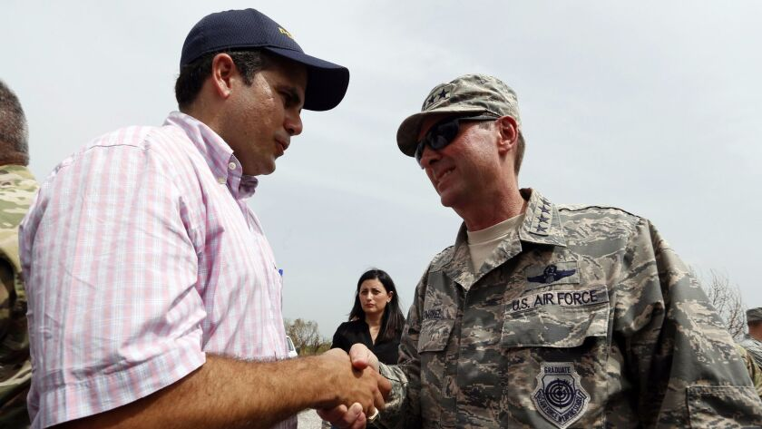 Puerto Rico Gov. Ricardo Rossello greets Gen. Joseph Lengyel, the head of the National Guard, after Lengyel's arrival at Camp Santiago on the island's southern coast on Sept. 27.