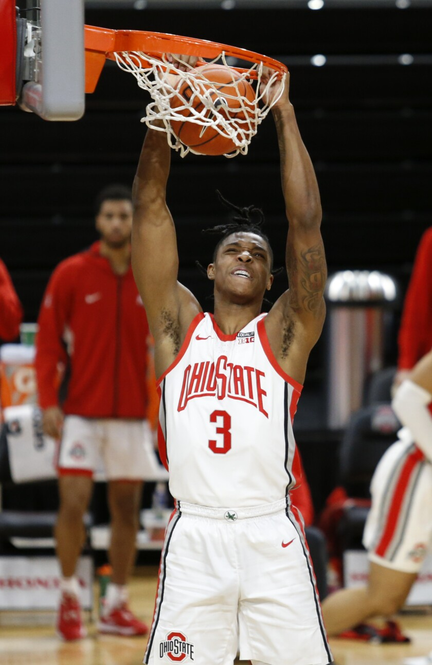 Ohio State guard Eugene Brown dunks against Morehead State during the second half of an NCAA college basketball game in Columbus, Ohio, Wednesday, Dec. 2, 2020. Ohio State won 77-44. (AP Photo/Paul Vernon)
