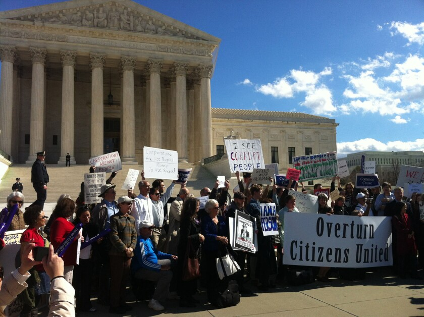 "Protesters outside the Supreme Court in 2012 rally against the court's decision in Citizens United, one of two rulings that has helped boost the influence of so-called ""dark money"" groups in elections."